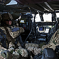 German Soldiers Seated In A Uh-60l by Terry Moore