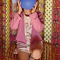 Girl Blowing Up Balloon by Sami Sarkis