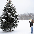 Girl Measuring Tree Height by Ted Kinsman