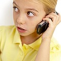 Girl Using Mobile Phone by Ian Boddy