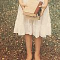 Girl With Old Books by Joana Kruse