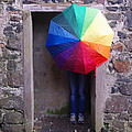 Girl With The Rainbow Umbrella At Mussendun Hall by Merrill Miller