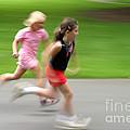 Girls Running by Ted Kinsman
