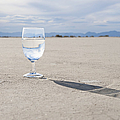 Glass of Water on Dried Mud by Thom Gourley/Flatbread Images, LLC