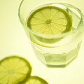 Glass Of Water With Sliced Lemon by Lawrence Lawry