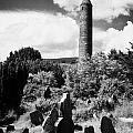 Glendalough Round Tower Ireland by Joe Fox
