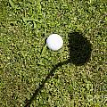 Golf Ball And Shadow by Mats Silvan