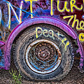 Graffiti Bus Wheel by Susan Candelario