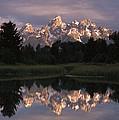 Grand Teton Range And Cloudy Sky by Tim Fitzharris