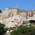 Greek Flag And Tourists On The Hilltop At Acropolis Crowded With Construction Crane In Athens Greece by John Shiron