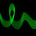 Green Abstract Coloured Lights Trails And Patterns by John Rensten