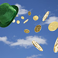 Green Hat Sweeping Gold Coins by Vstock LLC