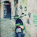 Green Vespa In Prague by Linda Woods