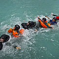 Group Swimming Technique During A Water by Stocktrek Images