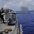 Gunner Fires A Mark 38 Machine Gun by Stocktrek Images