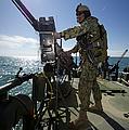 Gunner Mans A M240 Machine Gun by Stocktrek Images