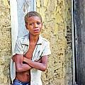 Haitien Boy Leaning On Wall by Johnny Sandaire
