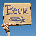 Hand Holding Up Makeshift 'beer' Sign by Pete Starman