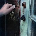 Hand Putting Vintage Key Into Lock by Jill Battaglia