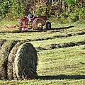 Hay Bale And Tractor by Duane McCullough