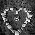 Heart Symbol Made Out Of Pebbles On The Beach At Aphrodites Rock Petra Tou Romiou Cyprus by Joe Fox