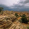 Heavy Clouds Over A Rocky Desert by Bill Hatcher