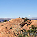 Hiker At Edge Of Upheaval Dome - Canyonlands by Gary Whitton