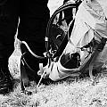 hiker hillwalker wearing boots waterproofs and rucksack in the highlands of Scotland UK by Joe Fox