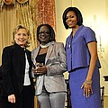Hillary Clinton And Michelle Obama by Everett