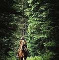 Horseback Riding On An Emerald Lake by Michael Melford