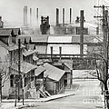 Houses And Steelmill by Photo Researchers