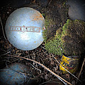 Hubcaps And Oil Cans by Steve McKinzie