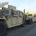 Humvees Sit On The Pier At Morehead by Stocktrek Images