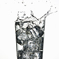 Ice Cubes Splashing Into Fizzy Drink by WALTER ZERLA