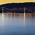 Illuminated Bridge Across A Bay by Bryan Mullennix
