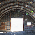 Interior Of Abandoned Farm Equipment Shed by Paul Edmondson