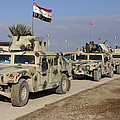 Iraqi Army Soldiers Aboard M1114 Humvee by Stocktrek Images