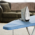 Iron On An Ironing Board by Ben Sandall