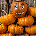 Jack-o-lantern On Stack Of Pumpkins by Garry Gay