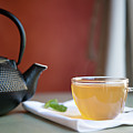 Japanese Cast Iron Teapot, Hot Tea And Mint Leaves by Alexandre Fundone