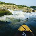 Kayak Noses Its Way Toward A Waterfall by Skip Brown