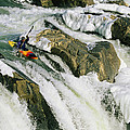 Kayaker At The Top Of A Waterfall by Skip Brown