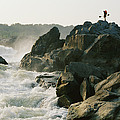 Kayaker Carries Boat Up The Rocks by Skip Brown