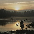 Kayakers Paddle Through Still Water by Sam Kittner