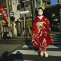 Kimono-clad Geisha Crosses A Street by Justin Guariglia