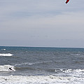 Kiteboarder With Kite In The Waves by Skip Brown