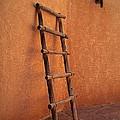 Ladder Against Adobe Wall by Matt Suess