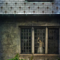 Lady By Window Of Tudor Mansion by Jill Battaglia