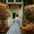 Lady In 19th Century Clothing By Conservatory by Jill Battaglia