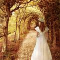 Lady Walking In Tree Tunnel In Garden by Jill Battaglia